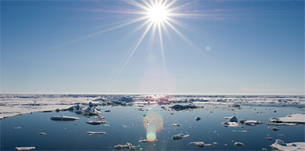 A photograph showing the bright Sun shining over the Chukchi Sea. The planet's far northern and southern latitudes are projected to experience the greatest change under increasing global temperatures - and in many cases they already are. Image: Chris Linder, Woods Hole Oceanographic Institution